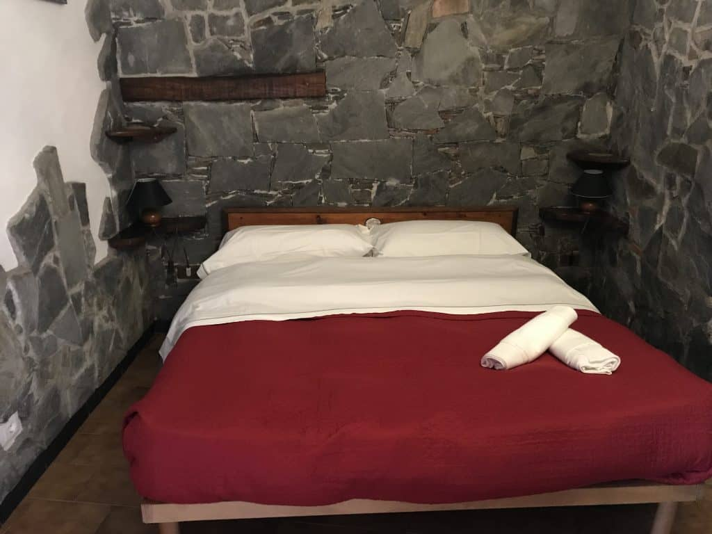 Bed in a room at Camere Giuliano in Vernazza Italy where I stayed during my solo travel to Italy
