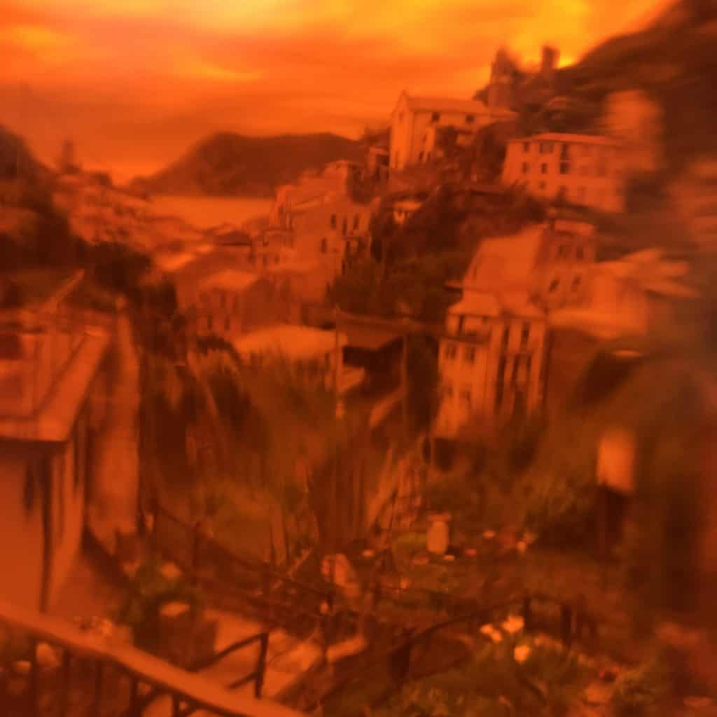 Abstract image of Vernazza Itlay taken through an orange bottle