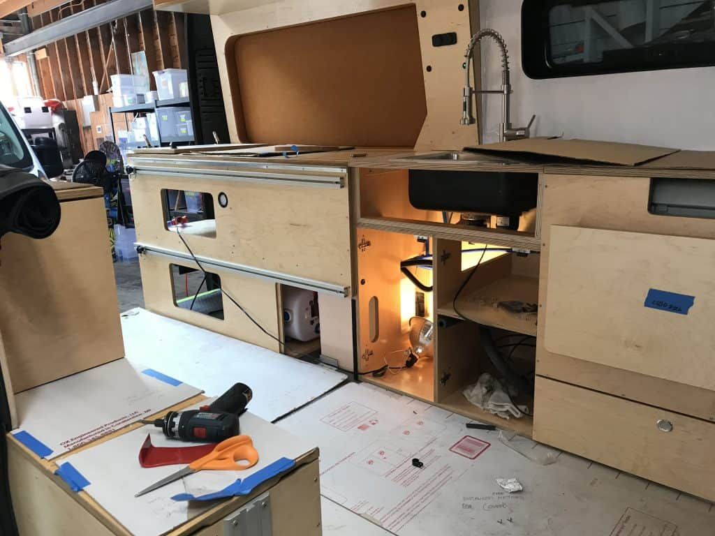 The inside of an unfinished Glampervan