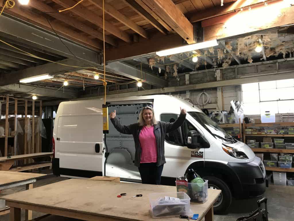 Sandra standing in front of a Glampervan in progress