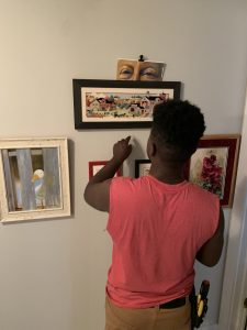 My son hanging pictures
