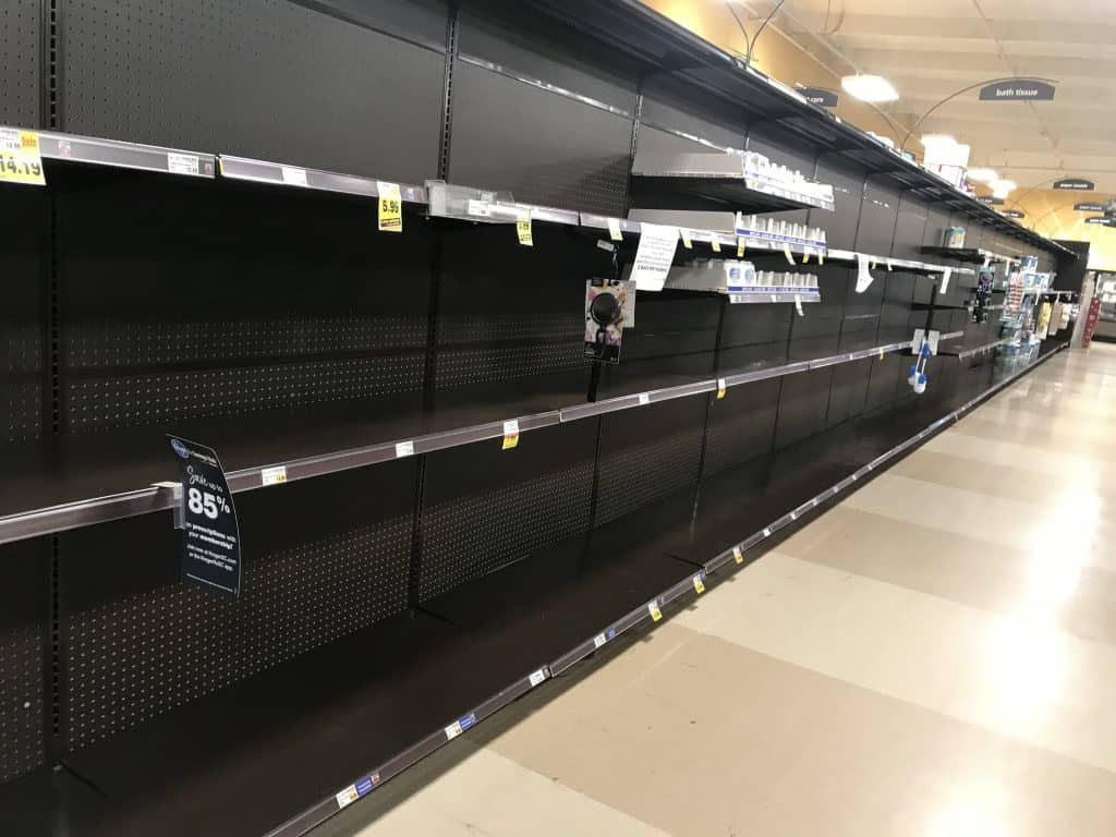 Empty grocery store shelves reminiscent of a dystopian book