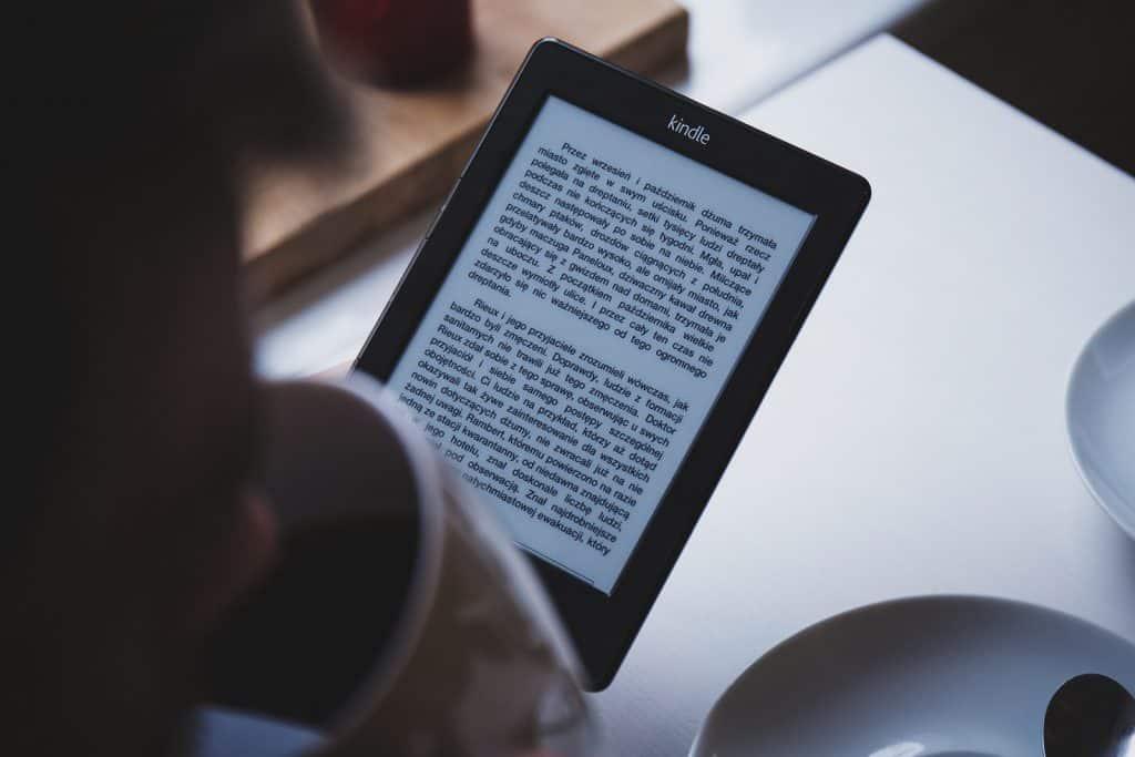 Person reading a kindle e reader