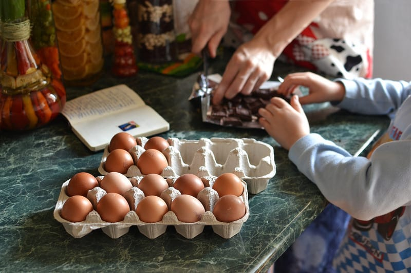 Photo by severyanka--246764. Parent and child cooking together. Caucasian.