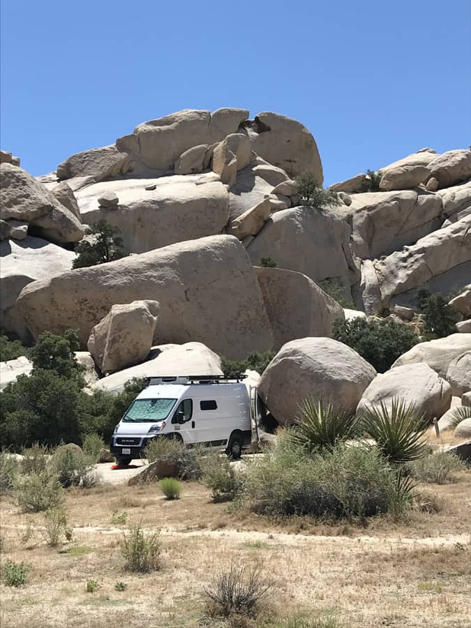 Van parked in Hidden Valley campsite in front of a jumbo boulder formation