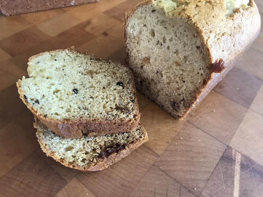 Date bread loaf and slices on cuttin gboard