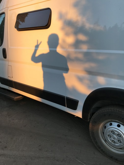 Sunset shadow on van showing peace sign