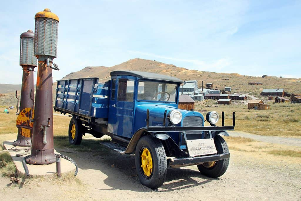 Bodie State Historical Park. 1920s truck with ghost town in the background.