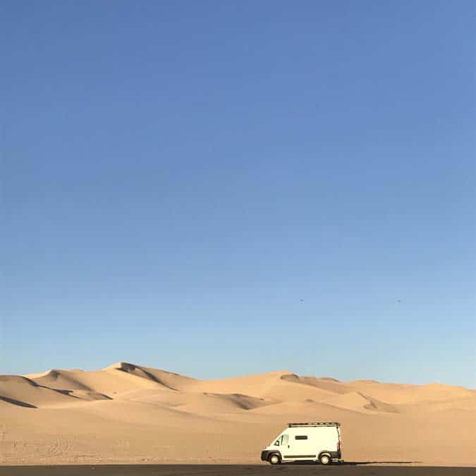 Promaster Van in front of Dunes at Imperial Sand Dunes. Women Camping Alone.