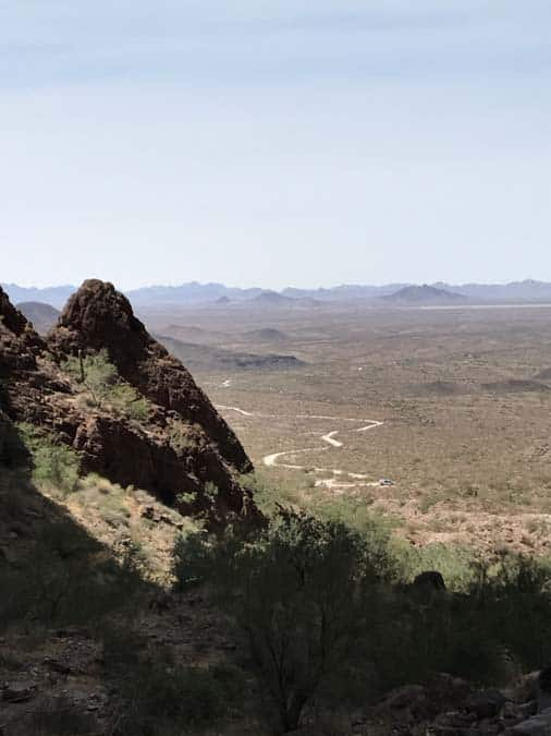 Curvy dirt road as seen from high up in Palm Canyon. Kofa National Wildlife Refuge.  A great place for women camping alone.