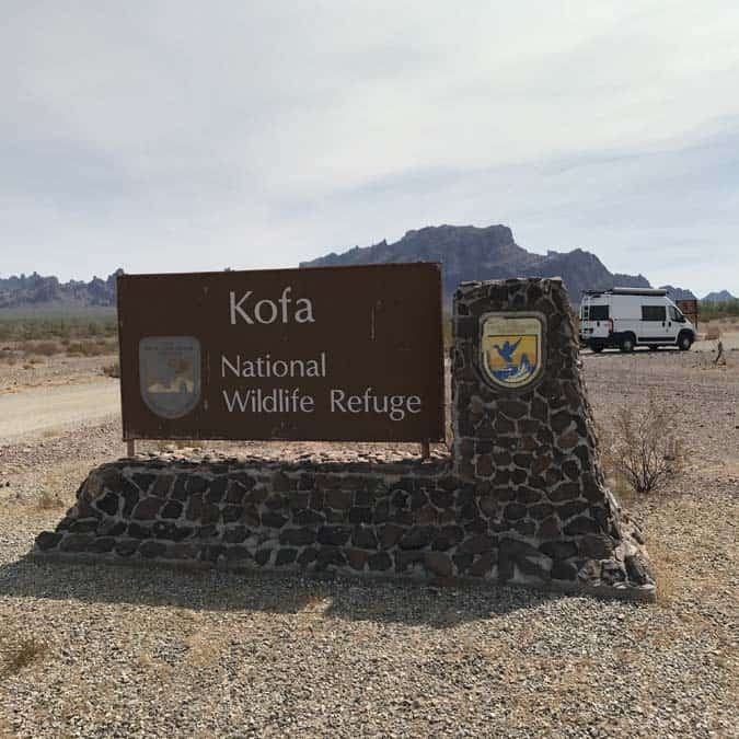 Kofa National Wildlife refuge with Ram Promaster van in background. Free camping in Arizona. A great place for women camping alone.