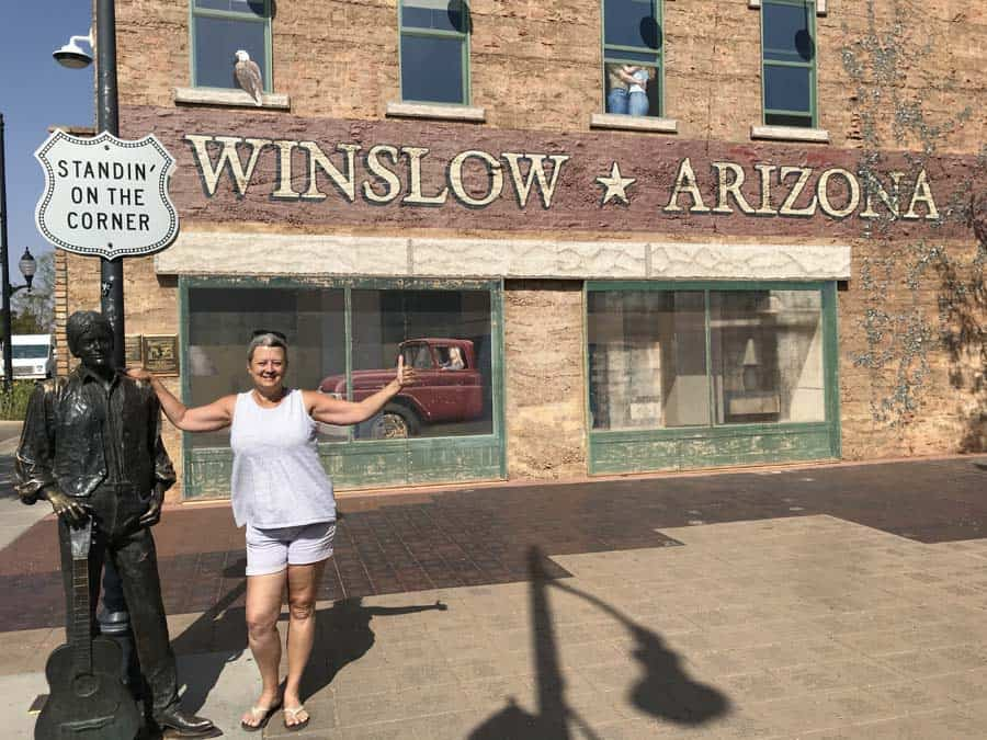 A woman camping alone, Standin' on the corner in Winslow Arizona