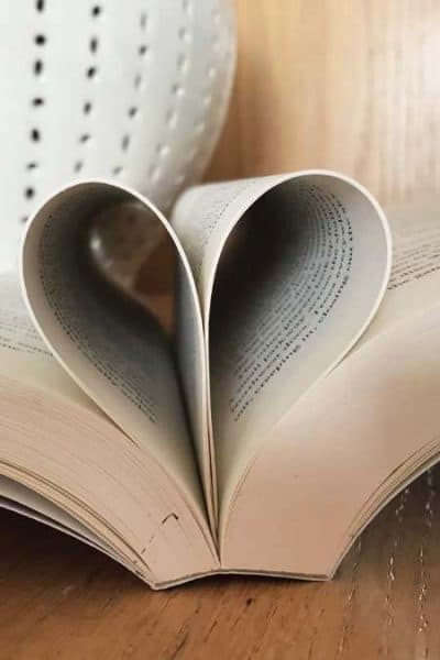 Best Feel Good Books open book with pages folded into heart shape - square image